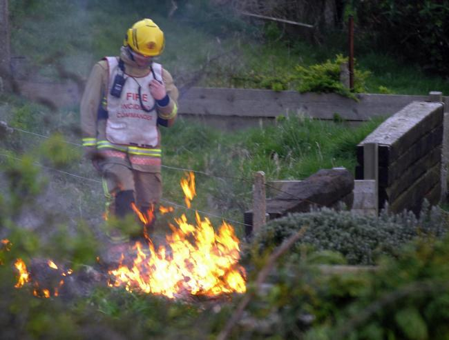 Firefighters bring under control a bonfire on Verne Common Road, Portland, 250311, Picture: FINNBARR WEBSTER F11479
