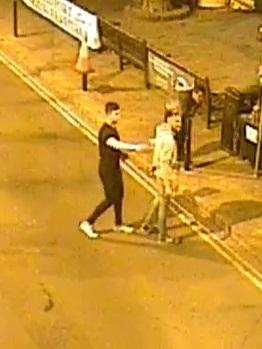 Police have released a CCTV image of people they would like to speak to after a fire extinguisher was stolen