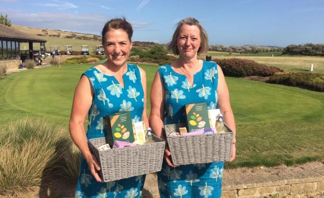 Invitation Day winners, Linda Alexander and Jane Blackenbery with their prizes.