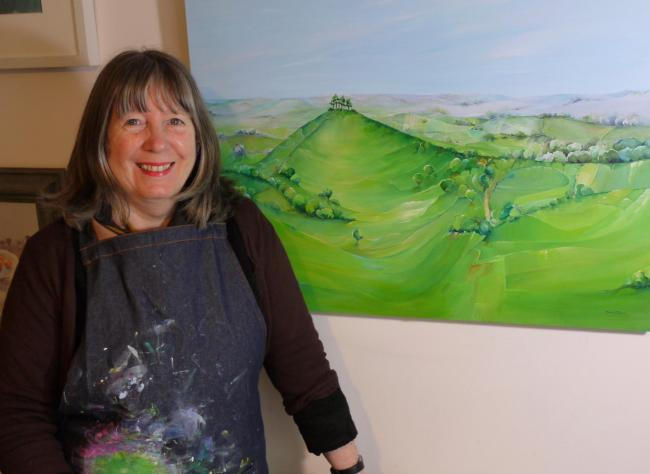 Artist Marion Taylor with one of her Colmer's Hill paintings