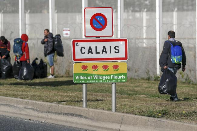 Migrants are moved on from a camp in Calais