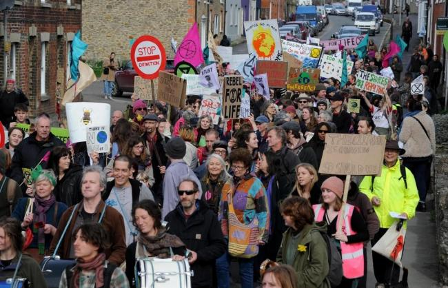 Extinction Rebellion marching through Bridport earlier this year