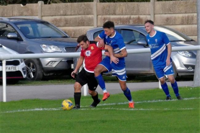 Bridport striker Stephen Friend, left, is nursing broken ribs 		      Picture: STEPHEN BARRETT