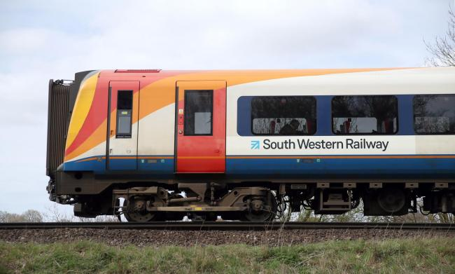 File photo dated 23/03/19 of a South Western Railway train. Hopes have been raised that fresh talks will be held in a bid to resolve the long-running dispute over guards on trains on one of the busiest rail franchises in the country. PA Photo. Issue date: