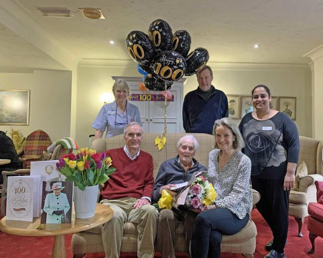 Derek Parsons celebrates his 100th birthday at Colten Care's Castle View care home in Dorchester. Derek is sat front centre with son Anthony Parsons, left, and daughter Jane Steenbuch, right. Behind them are, from left, nurse Lyn Davidson, son-in-law