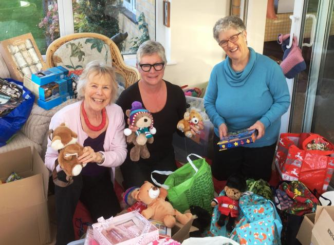 Friends of Dorset Women's Refuge, Margie Savory, Karen MacKay and Gill Smith wrapping presents for the residents