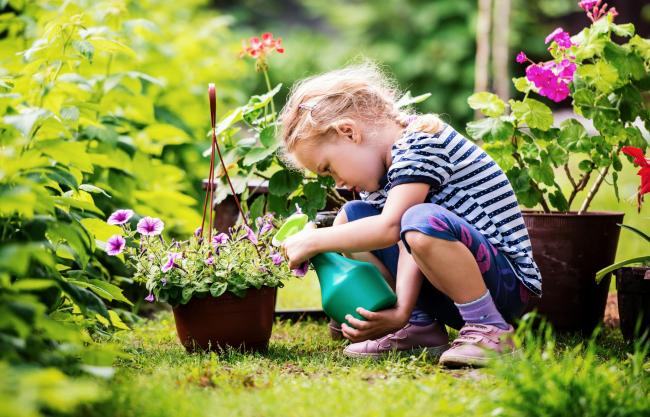 Undated Handout Photo of a child in a garden with flowers. See PA Feature GARDENING Advice Nature. Picture credit should read: iStock/PA. WARNING: This picture must only be used to accompany PA Feature GARDENING Advice Nature.