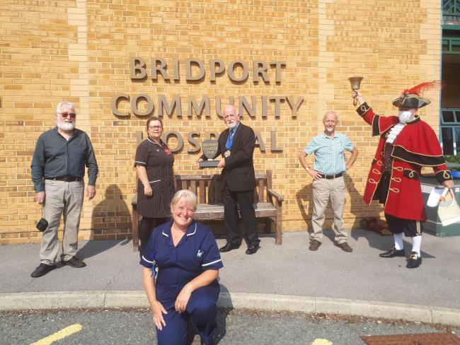 Bridport Community Hospital has been awarded the Bridport Charter Fair trophy for 'outstanding service to the community'