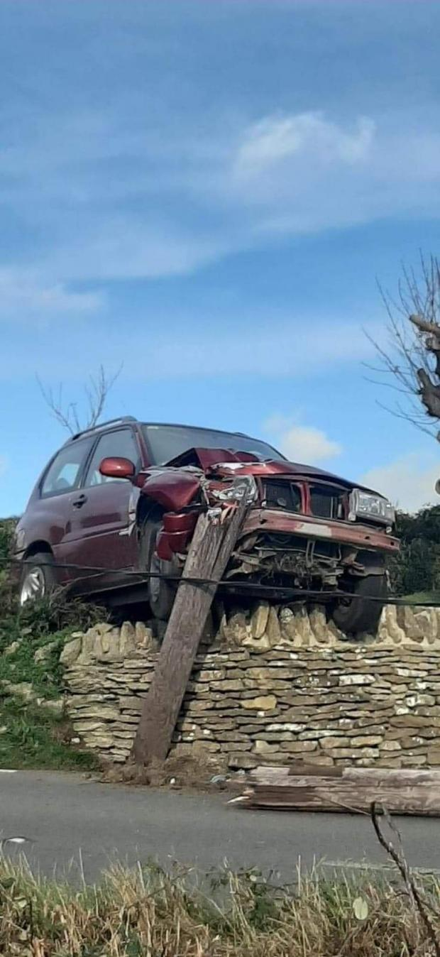 Bridport and Lyme Regis News: Burton Road in Burton Bradstock was shut for several hours after a vehicle crashed into an electricity pole. Picture: Katie Pile
