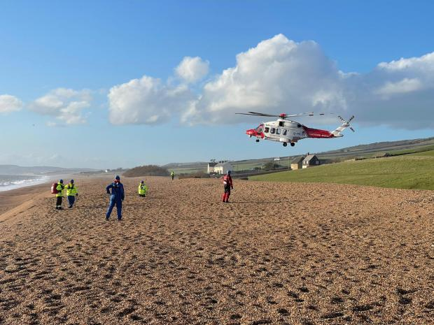Bridport and Lyme Regis News: The Coastguard helicopter taking off towards Dorchester