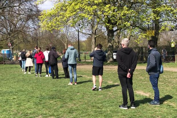 People queue for coronavirus surge testing on Clapham Common