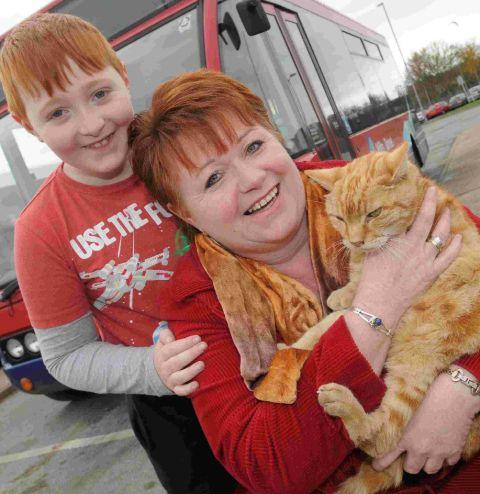 Fee Jeans and son Jack, eight, with their travelling cat Dodger in happier times