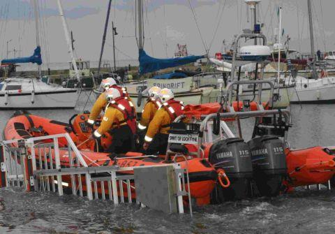 The new Lyme Regis lifeboat heads out on its first shout since arriving