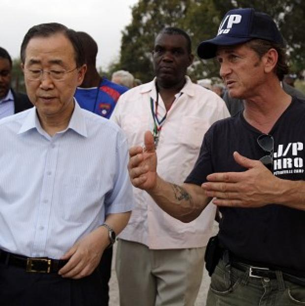 UN Secretary General Ban Ki-moon, left, listens to Sean Penn last month (AP)
