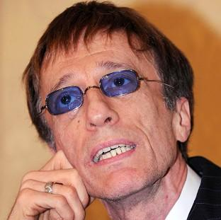 Bee Gees star Robin Gibb fell into a coma last week after contracting pneumonia in his battle against colon and liver cancer