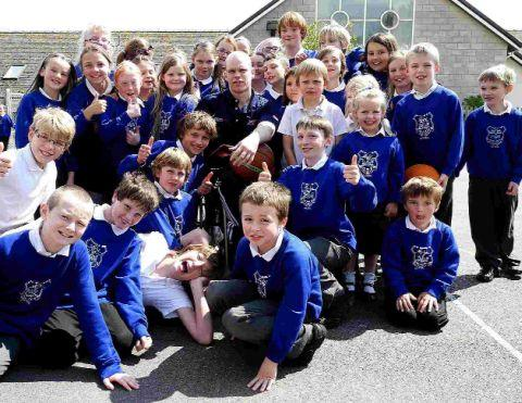 Pupils from the school gather around paralympian Jonathan Hall