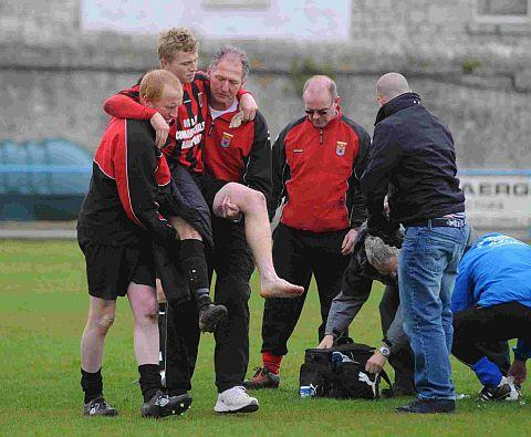 CARRIED OFF: Dan Peart is helped off after suffering a suspected broken ankle