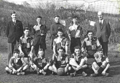 NEVER HAVE SO MANY.... The Bridport team with goalie Rex Harris in the centre at the rear