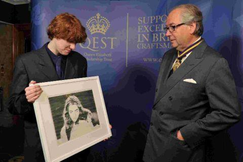 TALENTED AND CREATIVE: Alastair Barford shows a portrait to Hew Blair, president of the Royal Warrant Holders Association
