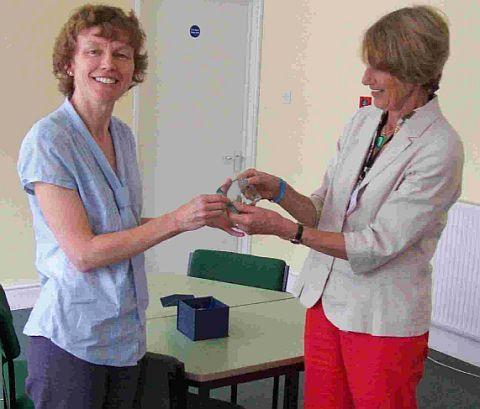 TIRELESS: Ruth Bizley gets her award from Stephanie Bromley