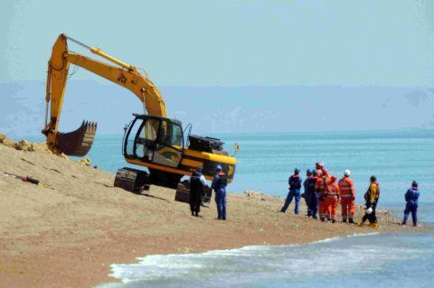 HEAVY EQUIPMENT: Emergency workers at Burton Bradstock beach
