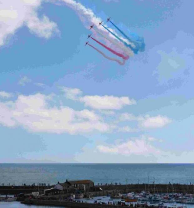 The Red Arrows soar over Lyme Regis