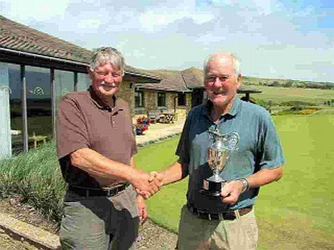AWESOME ANGUS: Angus Nicoll, right, receives the Roy Thompson Cup from veterans' vice-captain Roger Pollock