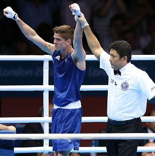 Great Britain's Luke Campbell, left, wins against Ireland's John Joe Nevin at the ExCeL arena in London