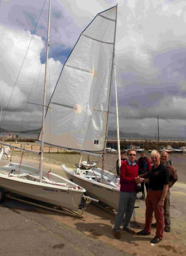 BUOYED: David Beer, commodore of Lyme Regis Sailing Club, thanks David Cozens, chairman of the Lyme Regis Club for Young People