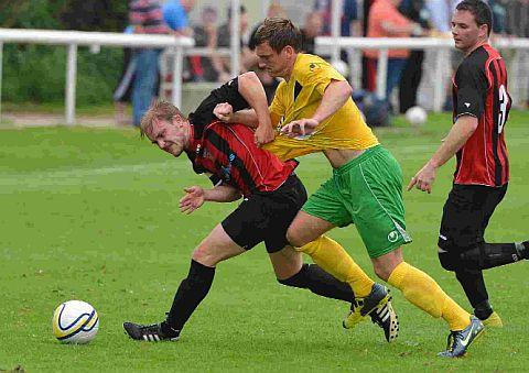 UNFORTUNATE OWN GOAL: Bees' defender Ryan Hayter, left