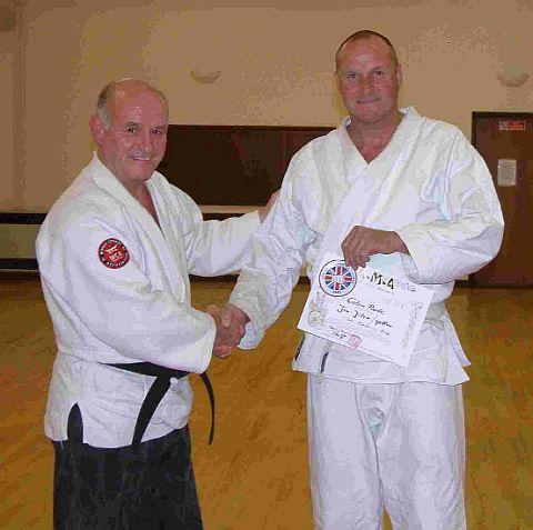 FIFTH DAN: Colin Poole receives his grading