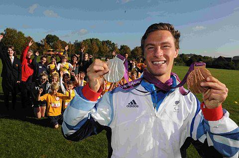STARRING ROLE: 2012 Paralympic double medallist Paul Blake was the special guest at the start of the Save the Children World Marathon Challenge at Colfox School