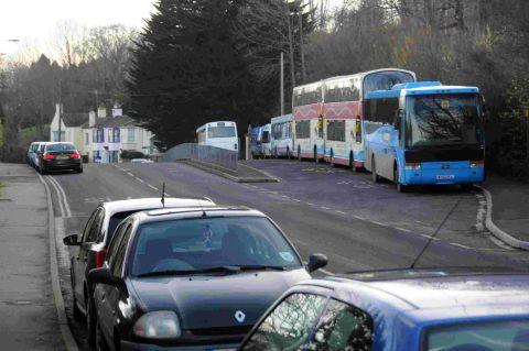 PROBLEMS: Cars parked on the road outside The Woodroffe School, Lyme Regis