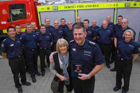 FAREWELL: Nigel Challis with his wife Audrey and Bridport firefighters