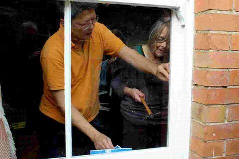 KEEP THE COLD OUT: Chit Chong showing Sally Collins how to seal a window frame