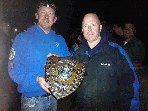 CHEER AT BEER: Beer & District SAC shore secretary, Chris Sweetland, left, presents the trophy to West Bay captain Simon Bowditch, right