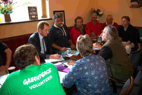 LET'S BE FRIENDS: South West MEP Graham Watson meets with Lyme Bay fishermen and Greenpeace volunteers as he supports the Be a Fisherman's Friend campaign
