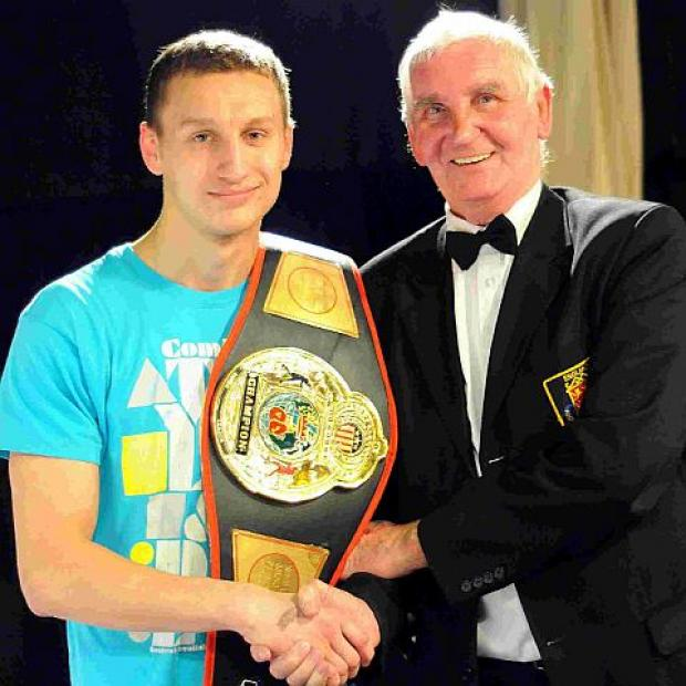 POLISH PRIZE: Wojgiech Wlizlo is presented with the Brian Richards Memorial Belt by coach Alan Slaney