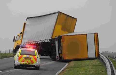 SIDE SWIPED: An overturned lorry and trailer on A35 near Litton Cheney