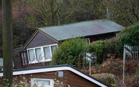 BUCKLED: A chalet is pushed forward by a landslip at Ware Cliff, Lyme Regis