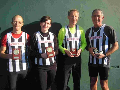 TOP TEAM: Bridport Runners, from left to right: Ben Wilshaw, Vicki Ackerman and Norman Wiggins with Pete Blackmore