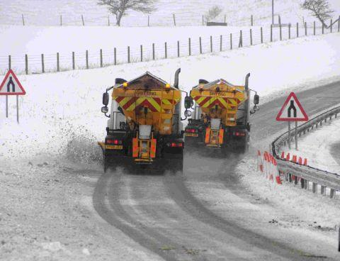TRUE GRIT: Gritting lorries clearing the snow from the A35 near the Litton Cheney junction