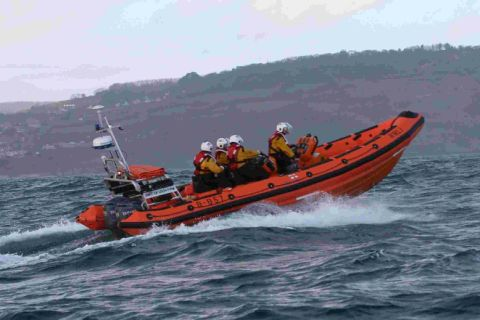 Lifeboat rescues three people stranded a mile out to sea