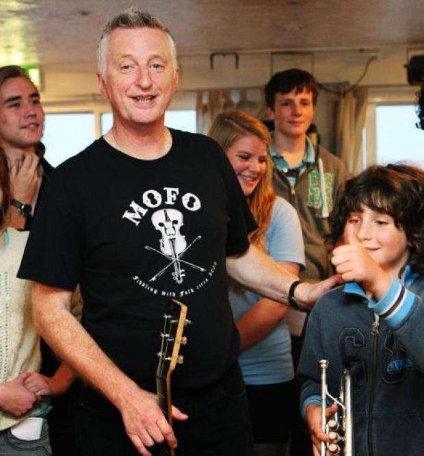 Billy Bragg with youngsters at a West Dorset  music group