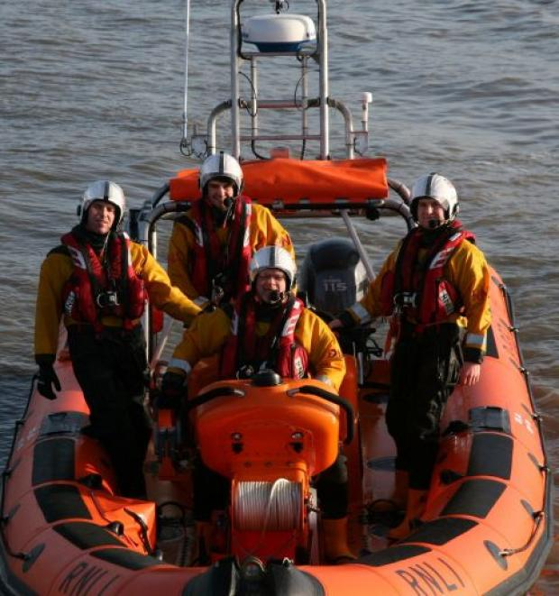 John 'Birdie' Bird takes the helm of Lyme Regis RNLI lifeboat for one last time