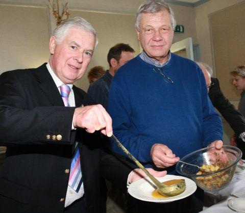 Lyme Regis Rotarians Bill Taylor and Peter Fortnam serve out the food at the annual Soup and Ploughman's Lunch