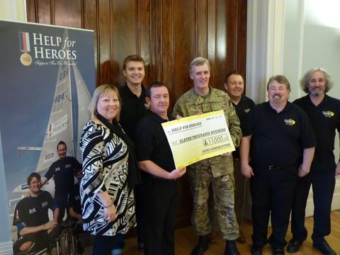 The Candles on the Cobb committee presents £11,000 to Major Peter Smith from Help for Heroes