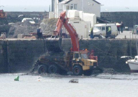 The dredging of Lyme Regis Harbour in a previous year