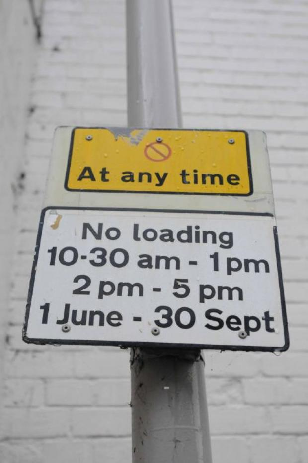 Traffic wardens enforce parking restrictions