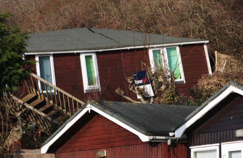 Stricken chalets at Ware Cliff in Lyme Regis